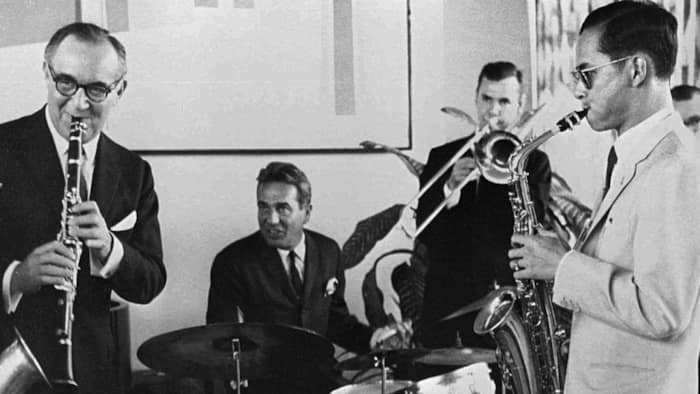 Thailand's King Bhumibol Adulyadej (far right) plays the saxophone during a jam session with legendary jazz clarinetist Benny Goodman (far left) and his band in New York on July 5, 1960. The king is an accomplished musician as well as a composer. This year marks the world's longest reigning monarch's Golden Jubilee, and American jazz legends such as the Count Basie Orchestra, Herbie Hancock, and Wayne Shorter have recently come to town to perform in his honor. (AP Photo)